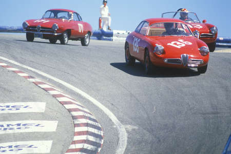motorcars: Vintage racecars speed along the track during the Laguna Seca race in California Editorial