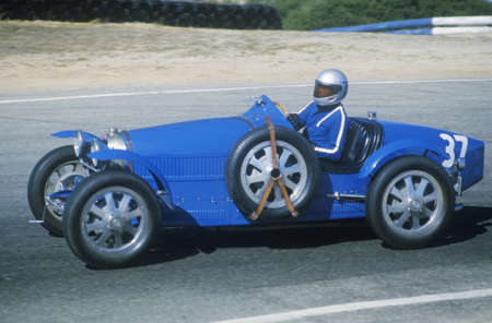 motorcars: Racing a classic Bugatti sports car at the Laguna Seca Classic Car Race in Carmel, CA Editorial