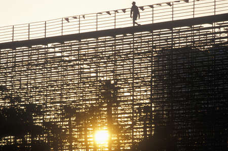indy: A silhouette of a person walking on the bleachers at the Toyota Grand Prix Race at the Indy Car World Series in Long Beach California