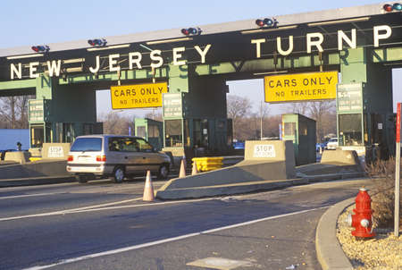 turnpike: Cars waiting to pass the New Jersey Turnpike Tollbooth Editorial