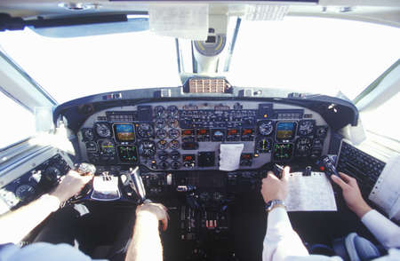 The cockpit and the pilots in a commuter airplane Editorial