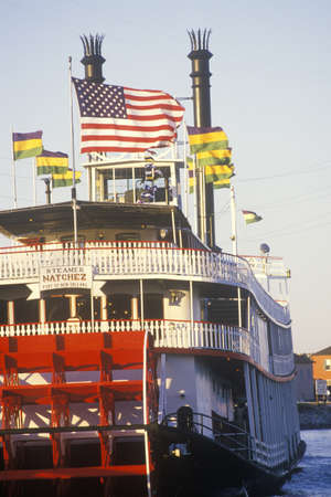 louisiana flag: Sunset on the Steamboat Natchez on the Mississippi River, New Orleans, Louisiana