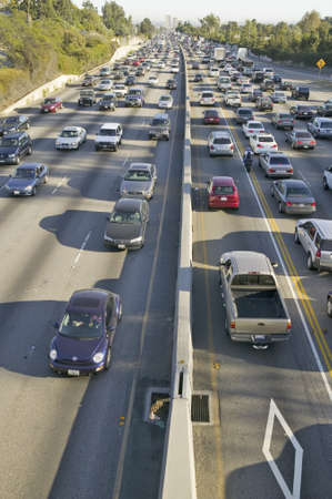 Diamond car pool lane on bottom right of 405 freeway near Sunset Blvd. at rush hour, Los Angeles, California Editorial