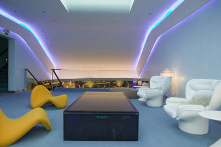 lounge: Interior view of modern seating furniture in first class lounge of Virgin Airlines at Heathrow Airport in London, England, United Kingdom
