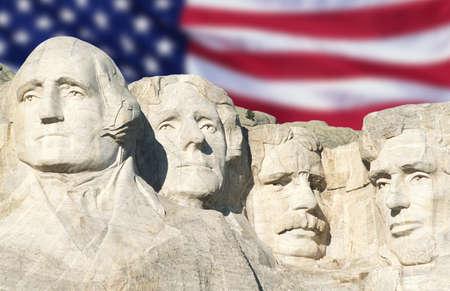 American flag behind Mount Rushmore