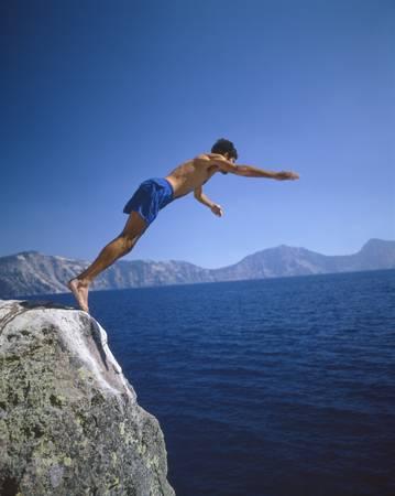 crater lake: Man diving into Crater Lake, Oregon
