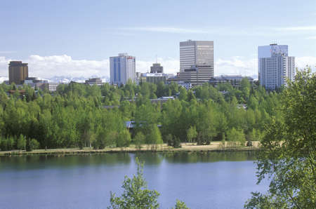 Skyline of Anchorage with Lake Spenard in the foreground and Mt. Hood in the back