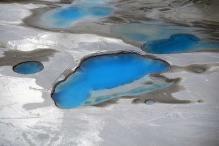 silt: Aerial view of silt and turquoise water in an Alaska glacier, Alaska