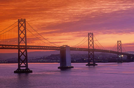 span: Sunset on the Bay Bridge to San Francisco from Treasure Island, California