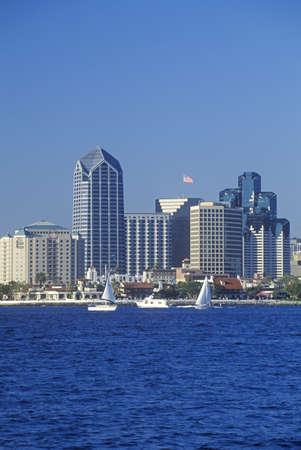 Sailboats sail in view of the San Diego skyline as seen from Coronado, San Diego, California