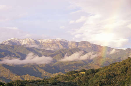 Rainbow and clouds over the Topa Topa Mountains in Ojai, California