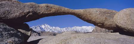 Panoramic view of Mount Whitney framed through Alabama Hills Arch in Alabama Hills near Lone Pine, California
