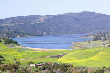 source: Elevated view of Lake Casitas and green fields in spring shot from Oak View, near Ojai, CA