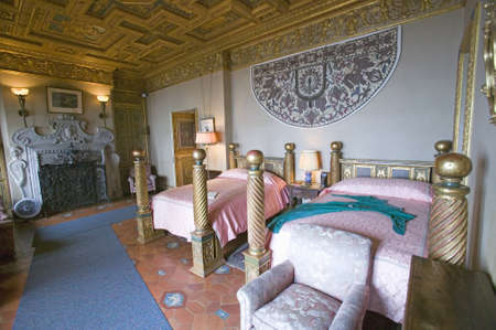 poster bed: Interior of guest bedroom with displayed antique clothing of the day at Hearst Castle, Americas Castle, San Simeon, Central California Coast