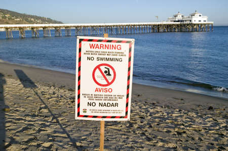 A �Warning - No Swimming� sign due to pollution at a Malibu beach, Malibu, California