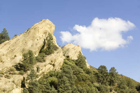 natural sciences: Rock and white puffy cloud on highway 33 on the way from Ojai California to Pine Mountain Club.