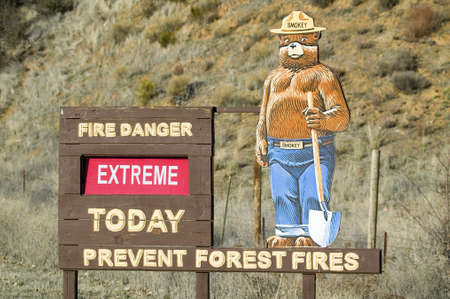 warns: Smokey the Bear warns of forest fires in Ventura County near Lockwood Valley, California on highway 33