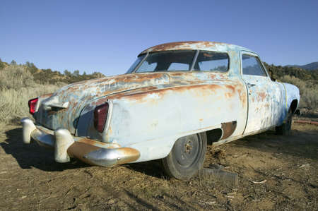 early 50s: Junk early 50s blue Studebaker deserted in field off highway 33, near Cuyama California Editorial