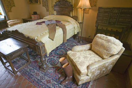 Riding boots and outfit displayed in guest room of Hearst Castle, San Simeon, California