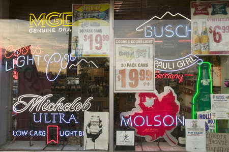 molson: Beer signs in neon in liquor store window of Connecticut Editorial