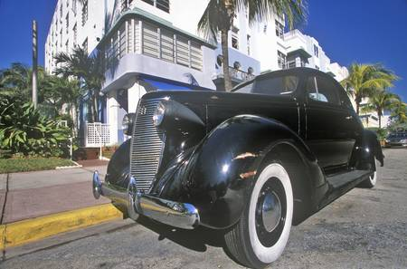 artdeco: Antique car with caricature of Humphrey Bogart driving in south beach, Miami Beach, Florida Editorial