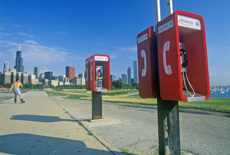 blader: Pay Telephones and Chicago Skyline, Chicago, Illinois Editorial
