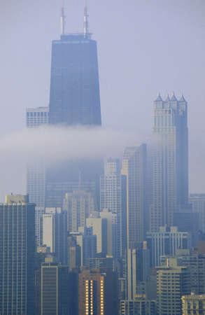 john hancock: John Hancock Building and cloud below in Misty Chicago Skyline, Chicago, Illinois