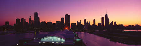 Panoramic view of Navy Pier and Chicago skyline at sunset, Chicago, IL