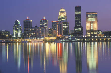 Evening on Ohio River and Louisville skyline, KY shot from Indiana Editorial