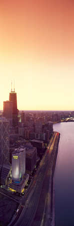 Panoramic view of Chicago skyline and John Hancock building at sunset, Chicago, IL