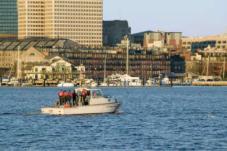charles county: U.S. Coastguard ship patrols Boston Harbor and the Boston skyline from terrorists at sunrise as seen from South Boston, Massachusetts, New England