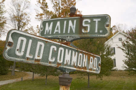 small town: Main Street USA and Old Common Road sign in autumn, western Massachusetts, New England Editorial