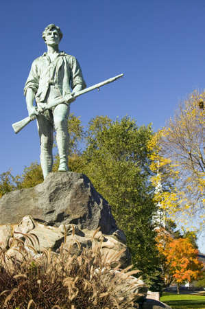 musket: Minuteman soldier from Revolutionary War greets visitors to Historical Lexington, Massachusetts, New England Editorial