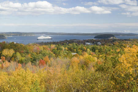 Autumn view from 1530 foot high Cadillac Mountain with views of the Porcupine Islands, Frenchman Bay and Holland America cruise ship in harbor, Acadia national Park, Maine