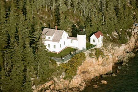 Aerial view of Bass Harbor Head Lighthouse, Acadia National Park, Maine, west side of Mount Desert Island