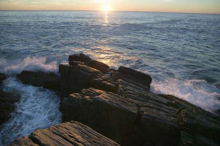 Sunrise view of rocky coastline near Portland Head Lighthouse, Cape Elizabeth, Maine