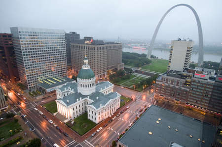 In a misty rain an elevated view of Gateway Arch and the historical Old St. Louis Courthouse.  The Courthouse was constructed of brick in the Federal style of architecture in 1826 and was the site of the Dred Scott slave decision, St. Louis, Missouri