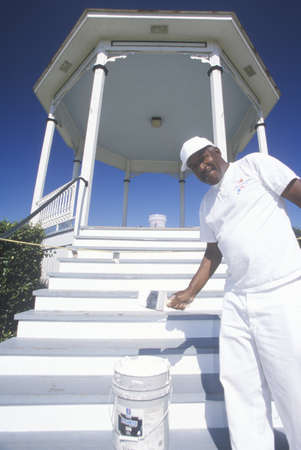 ms: African-American in Natchez, MS paints Gazebo with new coat of white paint