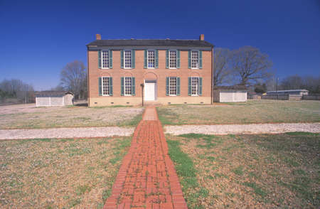 ms: Red brick sidewalk leading to Little Red Schoolhouse in Richland, MS, birthplace of Freemasonrys Order of Eastern Star Editorial