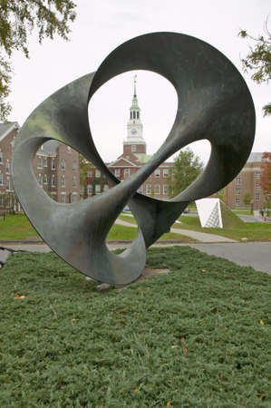 A metal sculpture stands in front of the Baker Tower on the campus of Dartmouth College in Hanover, New Hampshire