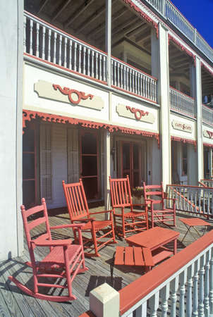 Rocking chairs on porch of Victorian home, the Sea Mist Apartments in Cape May,