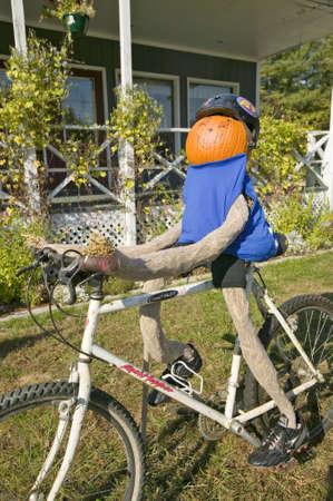 notch: A festive pumpkin rides a bicycle along Crawford Notch, New Hampshire