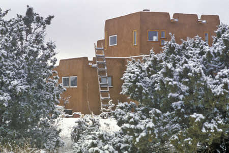 Adobe in snow in Santa Fe, NM
