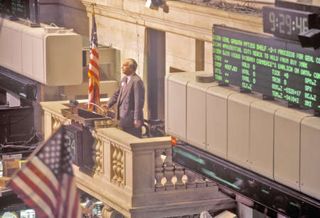 Opening bell on New York Stock Exchange, Wall Street, New York, NY Редакционное