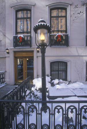 Christmas decor on historic home after winter snowstorm in Manhattan, New York City, NY