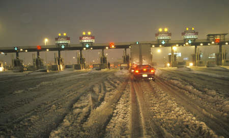 Toll gate in New Jersey after winter snowstorm and much snow at night