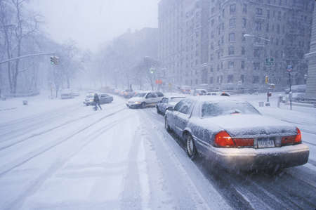 winter road: Cars in winter storm and fresh snow on Route 8095 in Fort Lee, New Jersey from New York City, NY