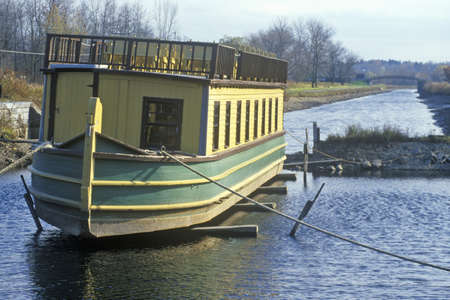 erie: Erie Canal village with barge in Rome, NY
