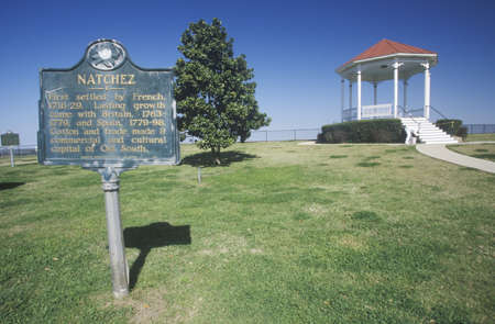 ms: Welcome to Natchez, MS - sign and gazebo in roadside park overlooking MS River Editorial