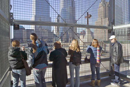Crowds view Cross at World Trade Towers Memorial Site for September 11, 2001, New York City, NY